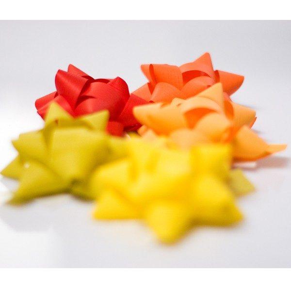 Pompones adhesivos papel sintético medianos surtidos de color amarillos naranjas rojos